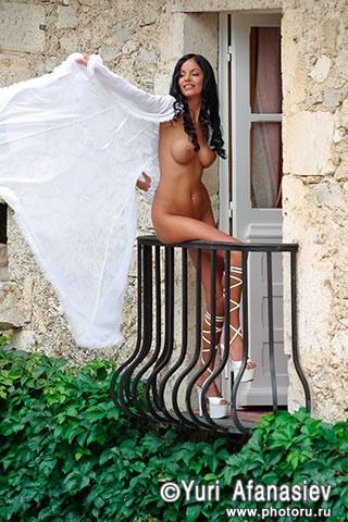 The nude girl photo on the balcony.